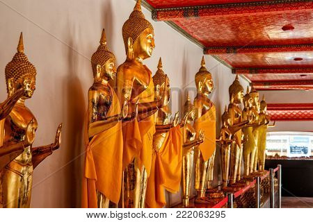 Gallery of statues of Golden Buddhas. Magnificent statues dedicated to Buddhism.