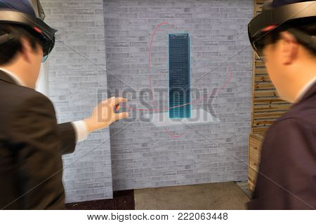 Smart industry technology  concept, civil engineer,architect (blurred) use augmented mixed virtual reality technology to see construction,building for design, analysis,diagnose,process in 3d