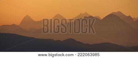 Golden sunrise near Gstaad. Summer morning in the Swiss Alps. Morning scene in the bernese Oberland, Swiss Alps.
