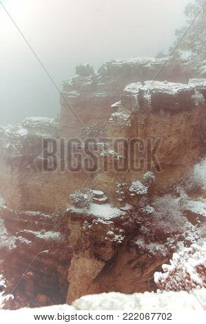 Grand Canyon winter snow storm, misty cliffs