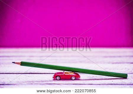 back to school. color pencil on toy car with copy space.
