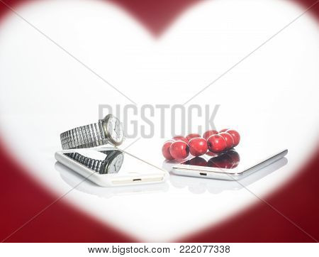 Valentine's Day. Picture in the form of heart. Bracelet, watches and phones
