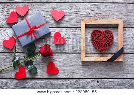 End of love and anti valentine day background. Red glitter heart in wooden frame with black ribbon. Breaking the relationships, separation and divorce, i hate valentine concept, top view