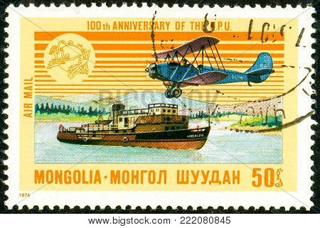Ukraine - circa 2018: A postage stamp printed in Mongolia shows Airplane, Steamship. Series: U.P.U. Universal Postal Union, Centenary. Circa 1974.