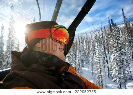 health lifestyle image of young snowboarder. Sheregesh Russia.