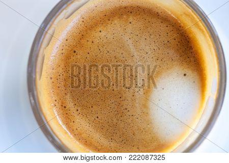 Close up top view cortado coffee froth