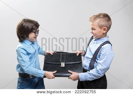 I am better. Waist up of angry boys businessmen fighting for a position in the company while holding briefcase. Isolated on background