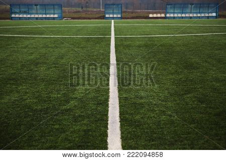 Tags on soccer field, white lines and grass.