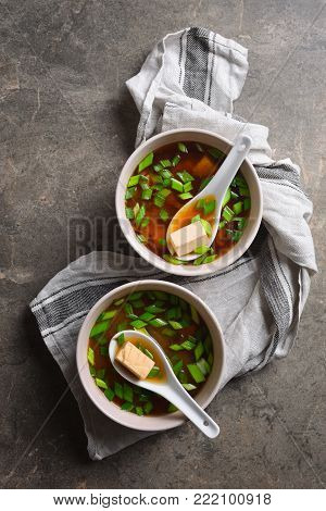 Traditional miso soup in two bowls, simply cooked tofu and miso sauce dish, rich source of vegan protein, view from directly above