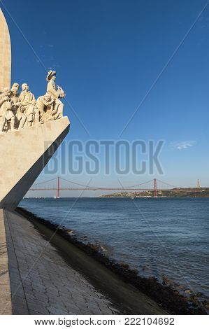 View of the Tagus River in Lisbon with the Monument to the Discoveries (Padrao dos Descobrimentos) and the 25 of April Bridge on the background; Concept for visit Lisbon poster