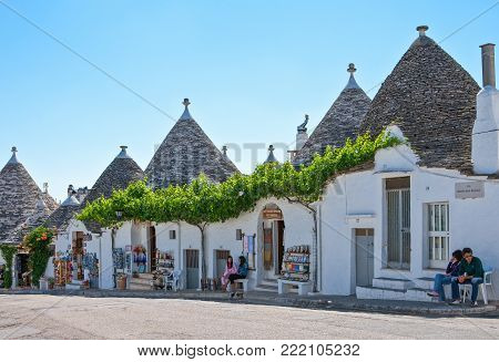 Alberobello, Italy - July 19, 2006: The old country center with the Trulli, rural dwellings of medieval origin made with dry stones and conical roof