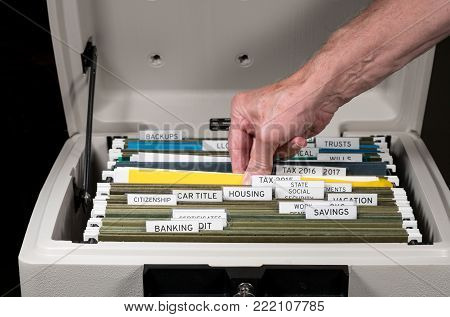 Close up of a well organized home filing system with tabs for each subject in fireproof safe