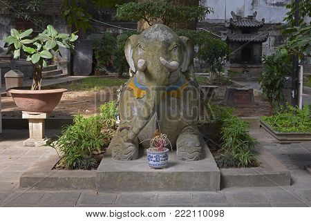 An elephant statue in the grounds of the historic Quan Thanh Temple in the Ba Dinh district of Hanoi, Vietnam. The temple, also known as Tran Vo Temple, was built between 1010 and 1028