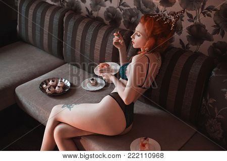 Black underwear. Underwear on a girl. Underwear on the model. Woman with pale skin and long red braids in underwear. Beautiful slender girl with red lips in sexy underwear. Redhead model