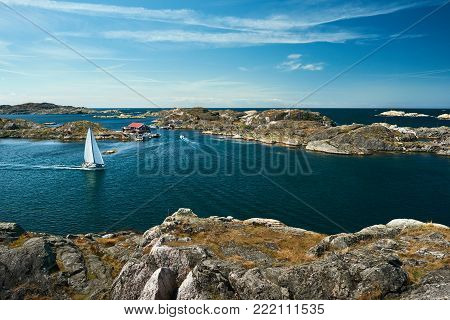 Sea Landscape With Sailboat And Rocky Coastline On The South Of Sweden. Southern Coastline Of Sweden