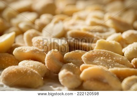 Peanuts sprinkled with salt, soft focus. Nutty background.