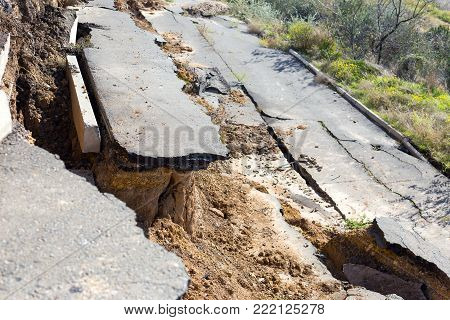 Broken Road Asphalt Cracked And Shifted By Landslide After Earthquake. Landslide Caused By Torrentia
