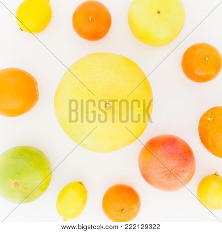 Fruits pattern made of lemon, orange, grapefruit, sweetie and pomelo on white background. Flat lay, top view. Fruit background