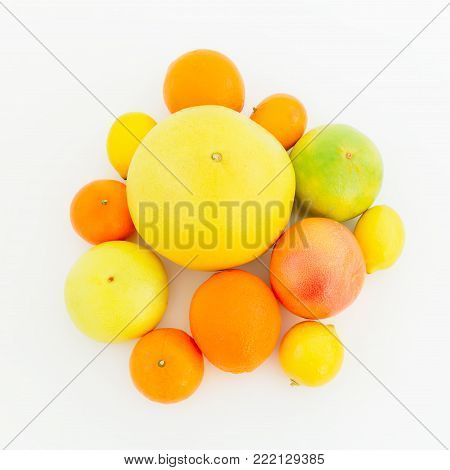 Lemon, orange, grapefruit, sweetie and pomelo on white background. Flat lay, top view. Fruit's background