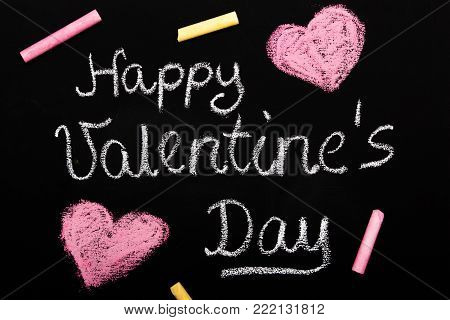 Happy Valentine's day card - Chalk drawing on blackboard with pink hearts,