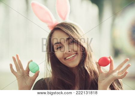 Girl With Rosy Bunny Ears Posing With Colored Eggs,
