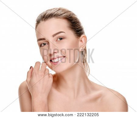 Cheerful smiling woman touching her facial skin after spa procedures