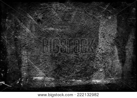 Black and white background abstract background. Scratched, vintage effect. The dark tonality. Grunge monochrome.