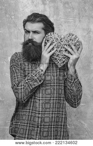 Bearded Man With Long Beard Holds Wicker Heart