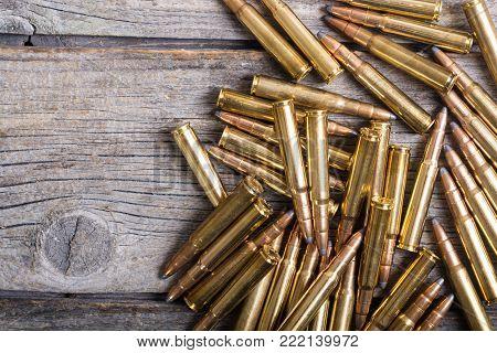Bullets . Gun cartridge 8mm caliber on wooden background