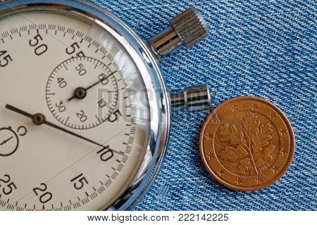 Euro Coin With A Denomination Of 5 Euro Cents (back Side) And Stopwatch On Blue Denim Backdrop - Bus