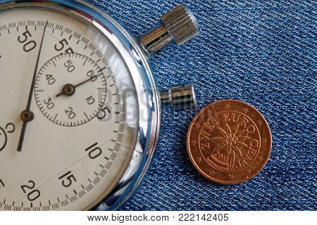 Euro Coin With A Denomination Of 2 Euro Cents (back Side) And Stopwatch On Worn Jeans Backdrop - Bus