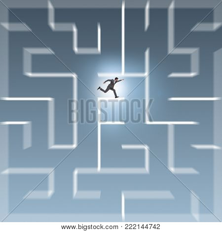 Businessman trying to escape from maze labyrinth