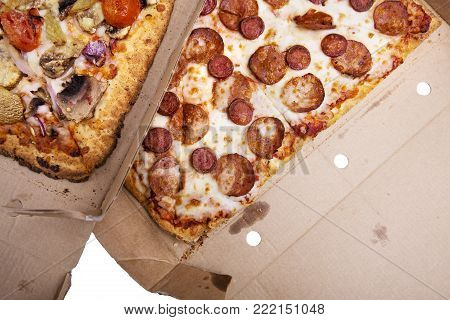 Delivery box with delicious pizza. Pizza to order. Pizza in a cardboard box.