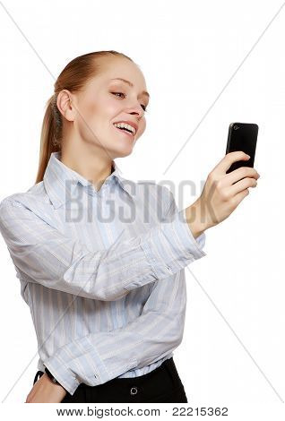 A smiling businesswoman using a mobile phone, over white