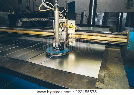 CNC laser plasma cutter. Modern metalworking technology at manufacturing plant or factory poster