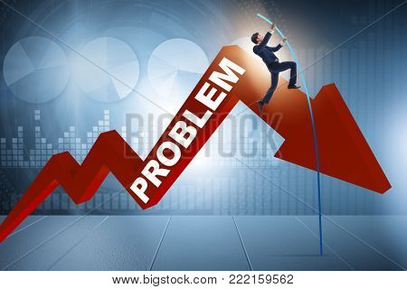 Businessman pole vaulting over problems in business concept