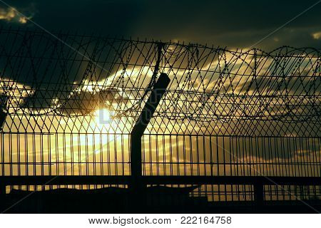 Airport guardrail at the days night stock image