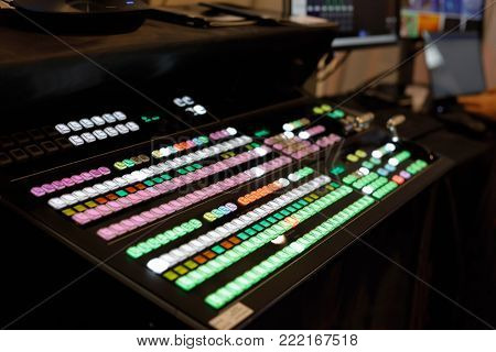 Close up view of video production switcher. Selective focus.