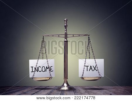 Income tax balance finance books scales concept