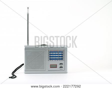 gray portable radio isolated on white background, devices which are popular in the past for music and news