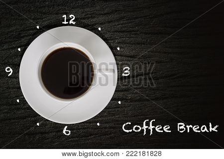 Cup of coffee the handle of which points to 3 pm. Coffee break concept