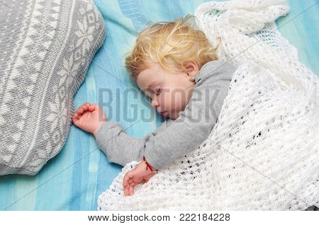 Cute Little Blonde Girl Sleeping On The Bed