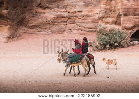 Petra, Jordan - December 21, 2017: Bedouin in the ruins of the old city of Petra in Jordan