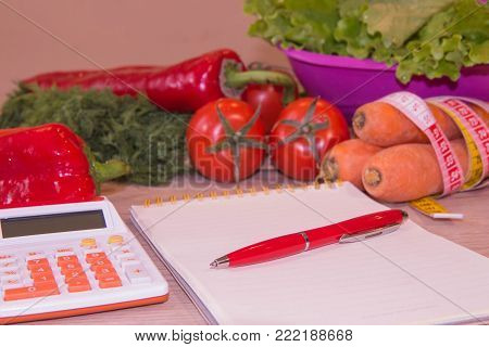 Concept of diet. Low-calorie vegetables diet. Diet for weight loss. Measuring tape and vegetables on the table. Vegetarian diet for weight loss