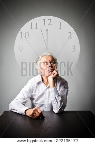 Old man in white is waiting. Three Minutes to Twelve. Time is passing.