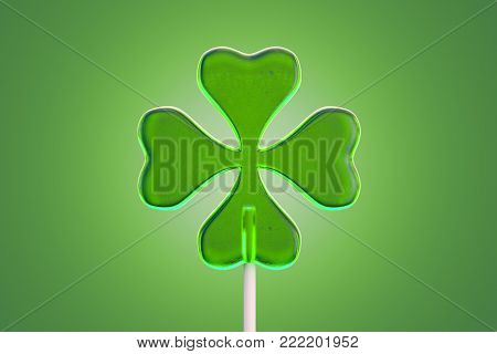 Lollipop candy in four leaf clover shape on green background. 3d rendering