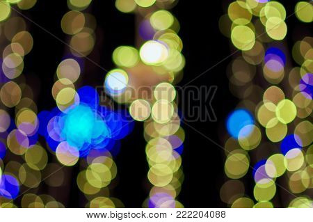 Abstract light celebration background with de focused lights with circular bokeh background of Christmaslight.