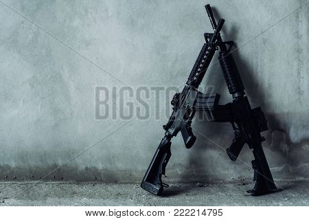 Double assault rifle on gray background, terrorist,robber concept.