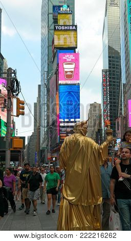 New York City, NY, USA 05.29.2016 lady liberty street performer and pedestrians on Times Square