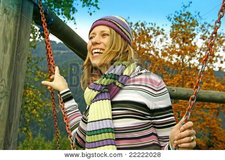 happy young woman on a swing